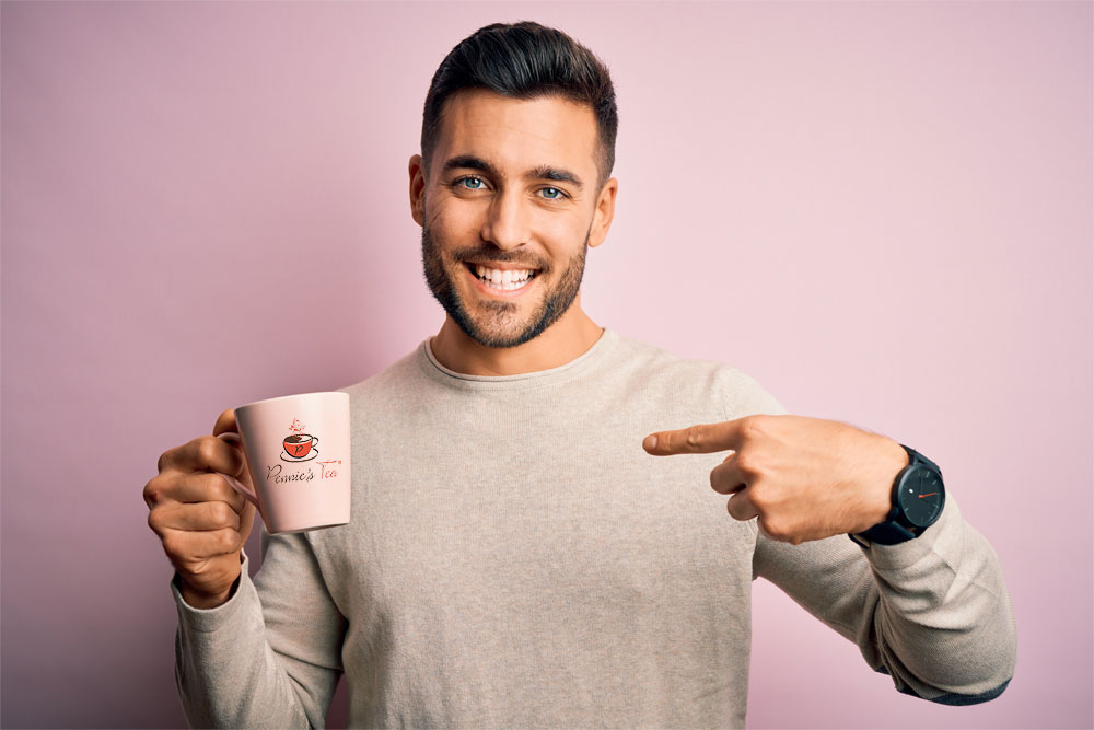 man holding a tea cup